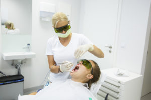 Patient receive laser dentistry