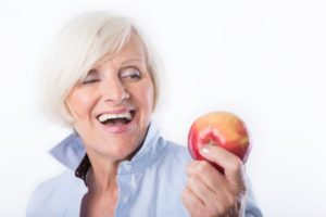 older woman with apple