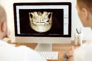 Dentists Looking at Digital Dental Image